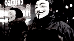 Nov. 2014 | Anonymous demonstrators at Ferguson solidarity march in downtown Chicago. | Photo/Emily Gray Brosious