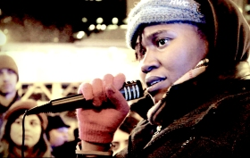 Nov, 2014: Chay, an organizer with Black Youth Project 100 Chicago, speaks out against police militarization and brutality at a Tuesday evening rally in downtown Chicago. | Photo/Emily Gray Brosious