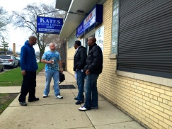 Apr. 2015   Bill DeBias (Center) talks with fellow parolees and classmates outside K.A.T.E.S. job training facility in South West Chicago.   Photo/Emily Gray Brosious