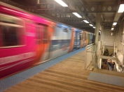Feb. 2014 | CTA Blue Line El Train with a Sea World ad wrap zooms by at the Western stop platform. (Photo/Emily Brosious)