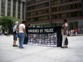 Aug, 28, 2013   Demonstrators marched through Chicago's Loop and rallied at Federal Plaza as part of the National Day of Protest Against Police Brutality. (Photo/Emily Brosious)