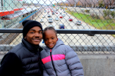 Nov. 29, 2013 | Red Line South Branch commuters Lenard Richardson and his daughter get around easier since the Red Line reopened. (Photo/Emily Brosious)