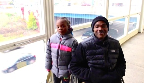 Nov. 2013 | Red Line South Branch commuters Lenard Richardson and his daughter get around easier since the Red Line reopened. (Photo/Emily Brosious)