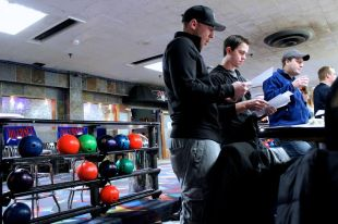 Feb. 4, 2014 | Matt Fleming (front) and Steve Mayer (middle) look over some plays between turns at Diversey River Bowling Alley. They meet here every other Monday for league bowling. (Photo/Emily Brosious)