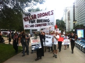 Sept. 28, 2013 | Antiwar Committee Chicago organizers leading the Midwest Action Against Drones march towards Boeing's Chicago headquarter building. (Photo/ Emily Brosious)