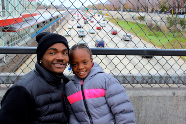 Red Line south branch commuters Lenard Richardson and his daughter get around easier since the Red Line reopened. (Photo/Emily Brosioius)