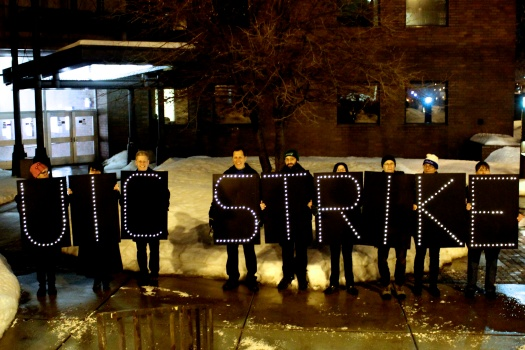 Overpass Light Brigade shows support for striking UIC faculty members Tuesday evening. (Photo/Emily Brosious)