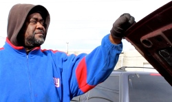 Mar. 2014 | David Ingram, a mechanic at A&A Auto Repair, located at 6435 S. State St., hopes this neighborhood will rising economic development in the wake of public housing high-rise demolitions. | Photo/Emily Gray Brosious