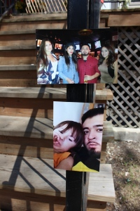 Family photos at memorial outside Ramirez' home / Photo by Emily Brosious