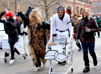 Mar. 2014   Costumed participants race grocery carts filled with canned food down Chicago's streets for the annual Chiditarod food drive.   Photo/Emily Gray Brosious