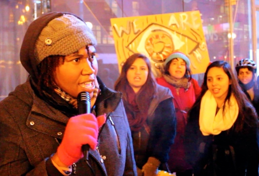 Chay, an organizer with BYP 100 Chicago, speaks out against police militarization and brutality at a Tuesday evening rally in downtown Chicago. (Photo by Emily Brosious.)