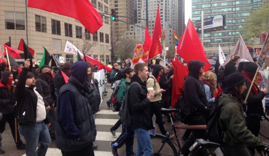(May Day demonstrators march through Chicago's Loop/ Photo by Emily Brosious)