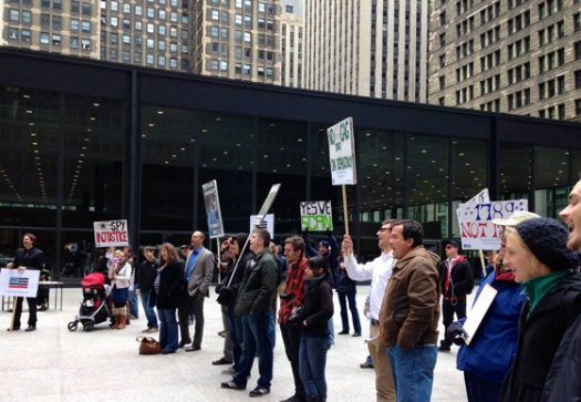 Demonstrators rally against mass surveillance in Chicago's Federal Plaza. (Photo/Emily Brosious)