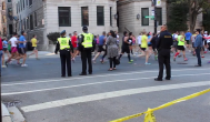 Oct. 2013   Chicago Marathon runners pass through Lakeview on Clark Street. Security has been beefed up this year in response to the Boston Marathon bombings.   Photo/Emily Gray Brosious