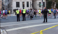 Oct. 2013 | Chicago Marathon runners pass through Lakeview on Clark Street. Security has been beefed up this year in response to the Boston Marathon bombings. | Photo/Emily Gray Brosious