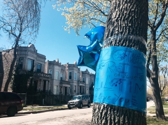 A memorial was in place Monday for Tim Triplett, who was shot to death in the 3500 block of West Flournoy on Sunday afternoon.   Emily Brosious/for Sun-Times