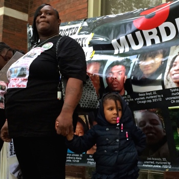 Panzy Edwards, the mother of 15-year-old Dakota Bright who was killed by Chicago police in 2012, addressed demonstrators Saturday evening before leading a march to the Third District Police Station. (Photo/ Emily Gray Brosious)