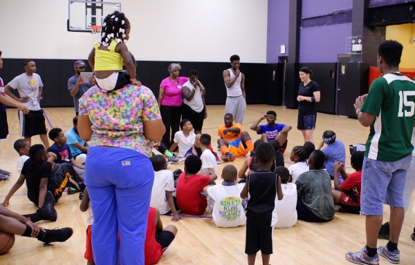 Chicago Police Officer Diana Varga answers questions from children and youth at the Foglia Family and Youth Center in Chicago's East Garfield Park neighborhood. (Photo by Emily Gray Brosious)