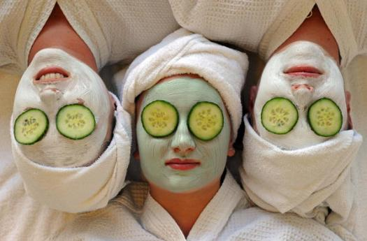 Women undergo facial beauty treatments a